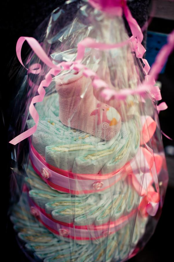 Cake for the beautiful baby. Lovely pink socks. Vanilla. Affection. Happiness. Pink cloud of happiness. Excellent gift. It is done. With loving care.Happy royalty free stock photography