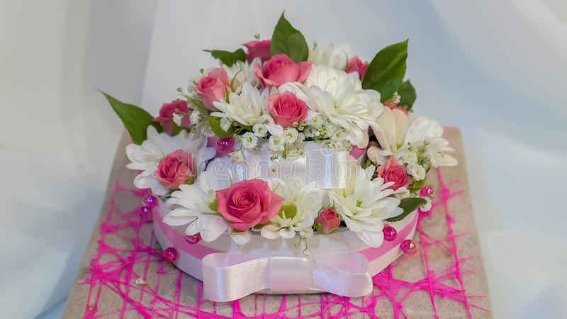 Cake of a beautiful and fresh flowers. The cake of a beautiful and fresh flowers royalty free stock photo