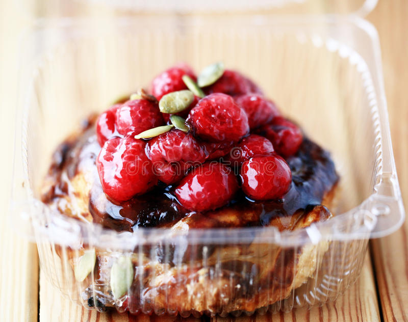 Cake with berries in a plastic bag. Home delivery stock photography
