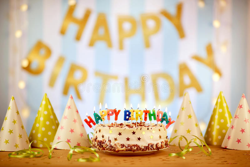 Cake birthday candles with letters in vintage style royalty free stock photography