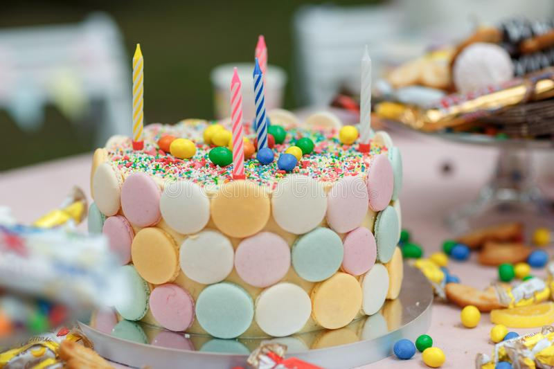 Cake birthday candles with letters in vintage style stock image