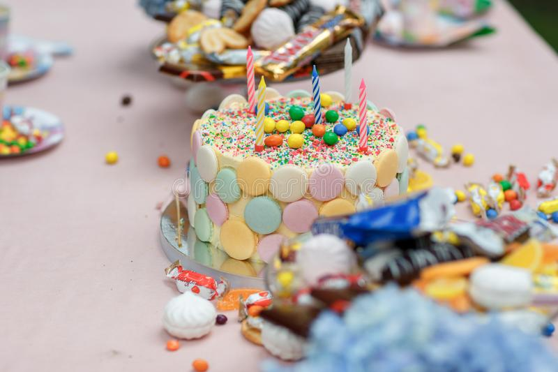Cake birthday candles with letters in vintage style royalty free stock images