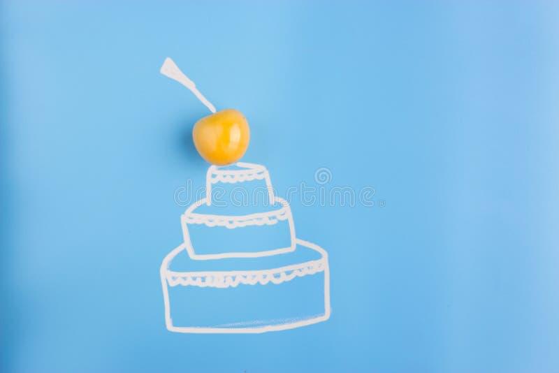 cake on blue background royalty free stock photography
