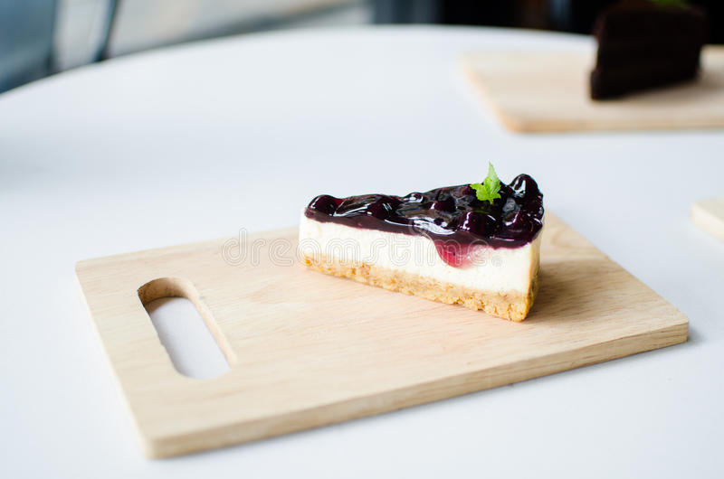 Cake. Blueberry cheese cake on wood plate stock photography