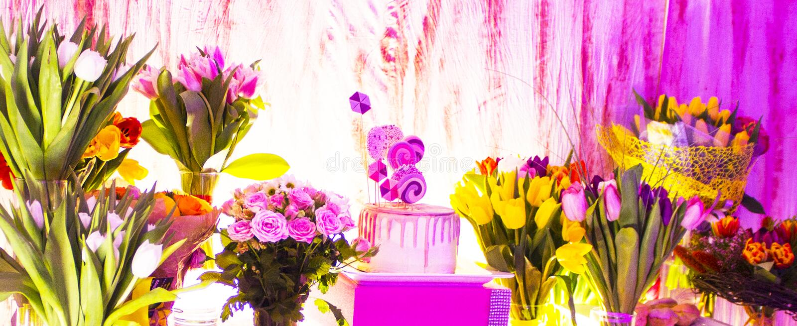 Cake and bouquets of flowers. Birthday royalty free stock images
