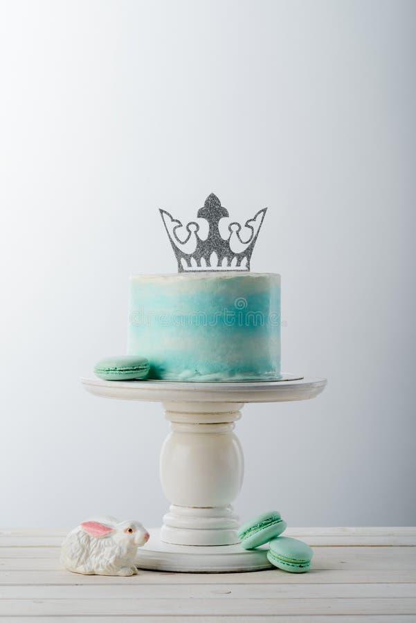 Cake, bunny and macaroni sweets stock photography