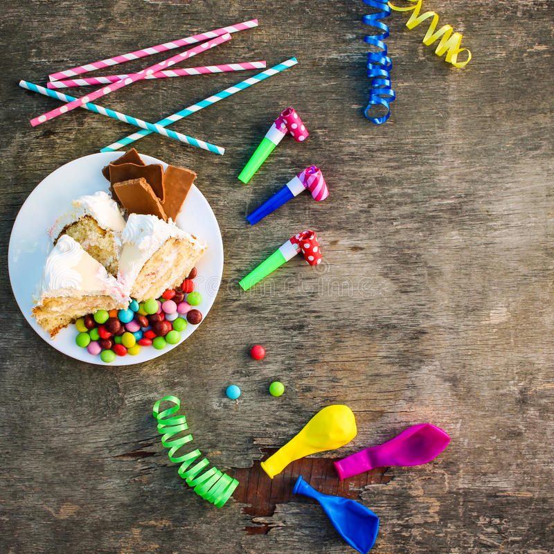 Cake, candy, chocolate, whistles, streamers, balloons royalty free stock photos