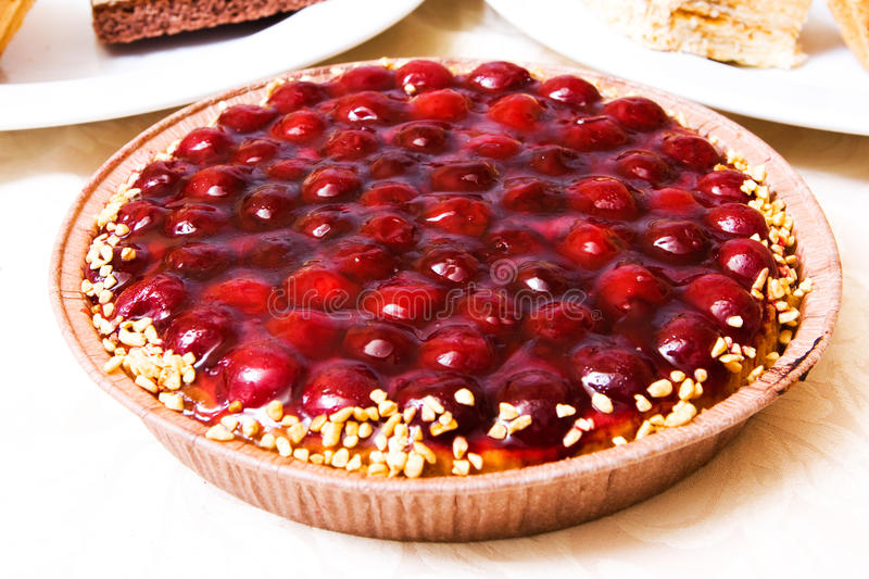 Cake with cherry. Close-up photo of fancy cake with cherry stock photography