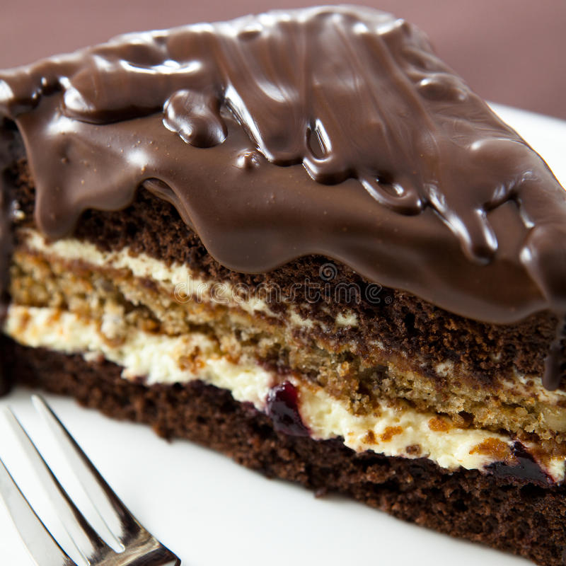Cake with chocolate glaze. Close up of cake with dark chocolate cake stock photo