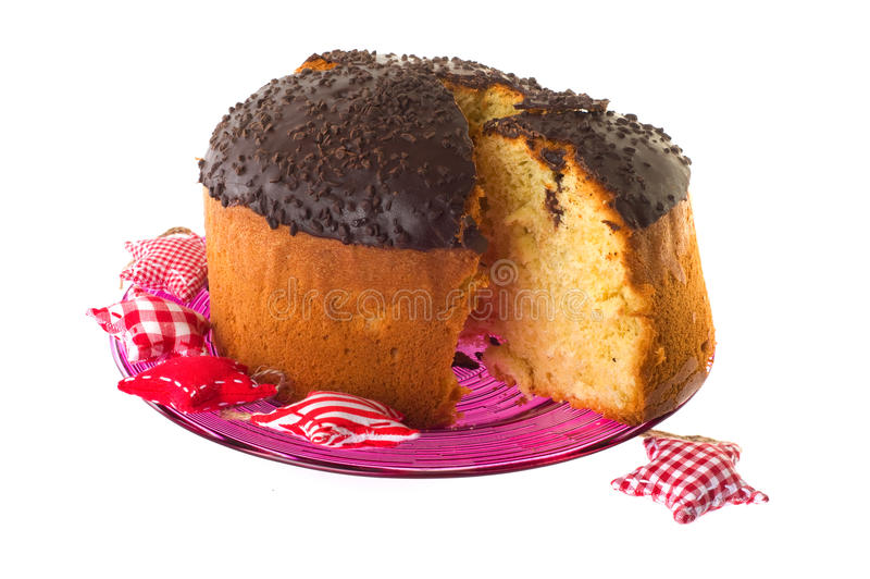 Cake with chocolate topping. Sweet cake with chocolate topping on pink glass plate stock photos