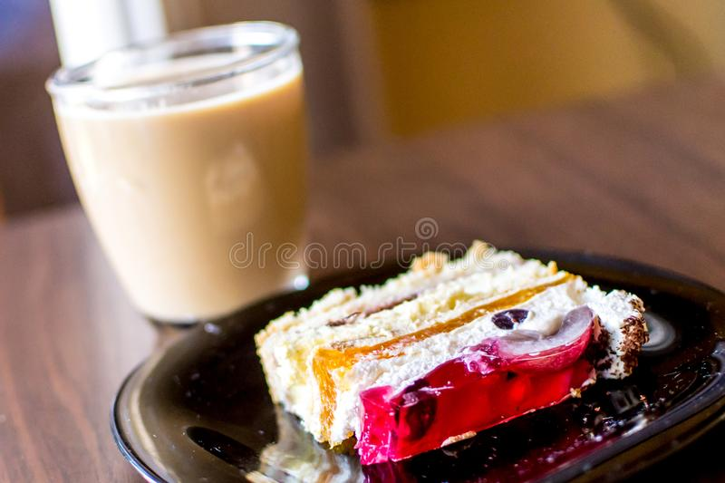 Cake and coffee on table royalty free stock image
