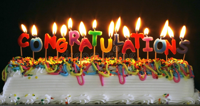Cake with congratulations candles. Colorful cake with lit candles spelling congratulations royalty free stock photos