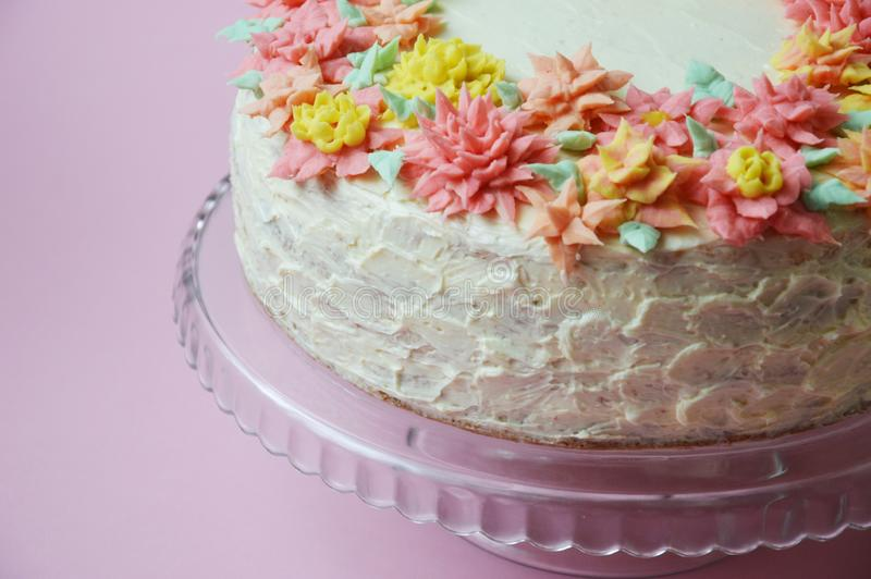 Cake with cream flowers on a light background. royalty free stock photography