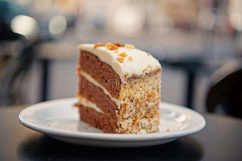 Cake with cream, food. Cake slice on white plate in paris, france, dessert. Temptation, appetite concept. Dessert, food stock image