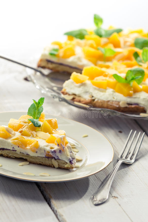 Cake with cream and peaches stock photos
