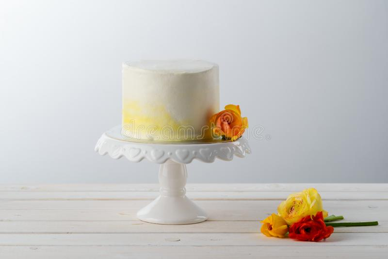 Cake decorated with fresh flowers stock photo