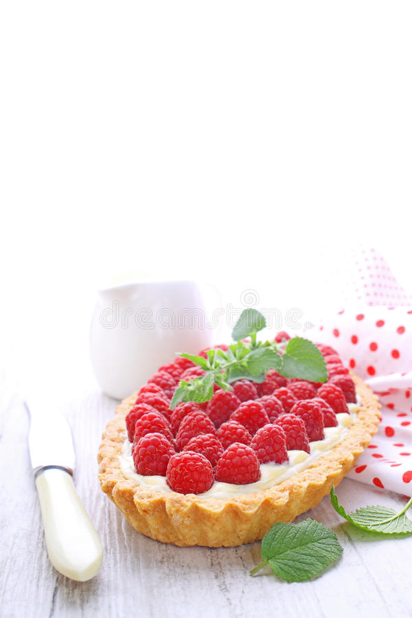 Cake decorated with raspberries mint leaves royalty free stock photos
