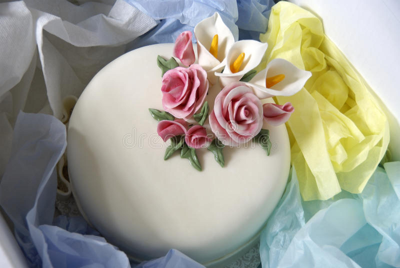Cake in a delivery box. Cake packed in a delivery box royalty free stock photo