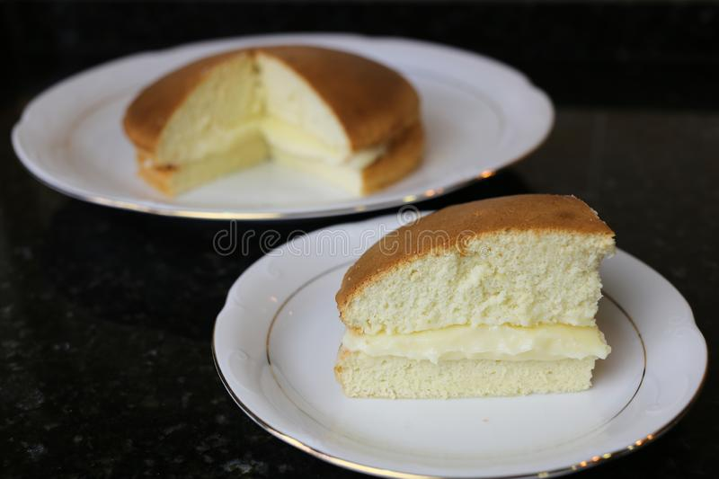Sponge cake with cream Genovese sponge cake. Cake filled with cream also known as Genovese biscuit. It is a sweet for breakfast and snacks or as a dessert royalty free stock photo