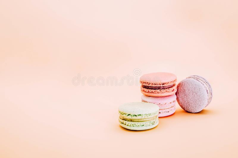 Cake french macaroons, sweet colorful macarons in vintage pastel colored on light background stock photos