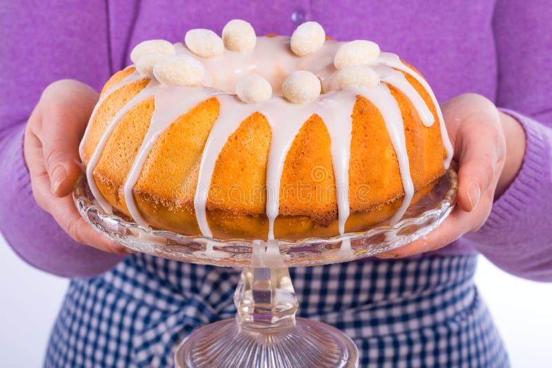 Cake glaze preparation. A tasty cake glaze preparation stock image