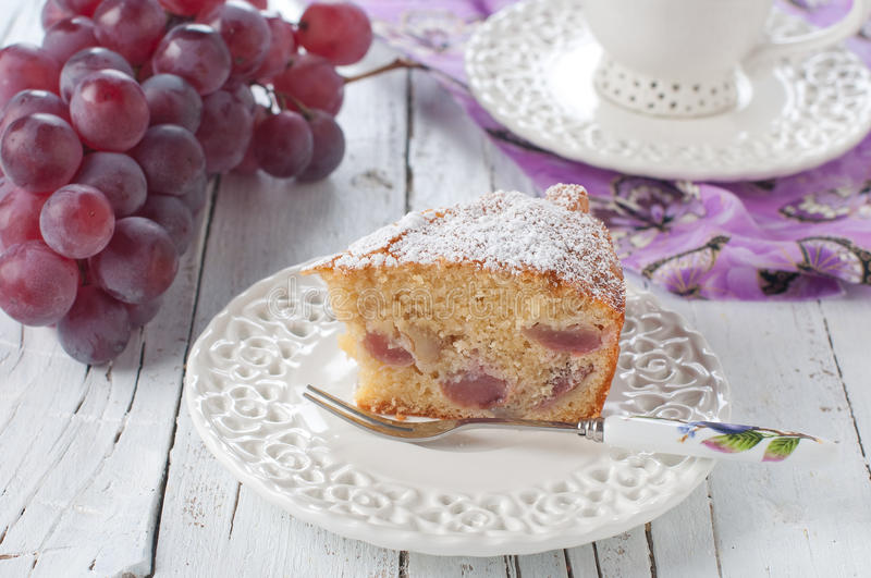 Cake with grapes stock images