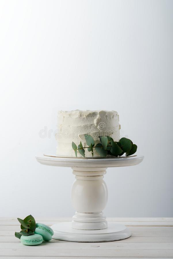 Cake and green leaves stock photos