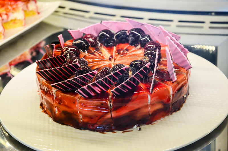 Cake. Home made Turkish cake decorated with fresh strawberry royalty free stock photos