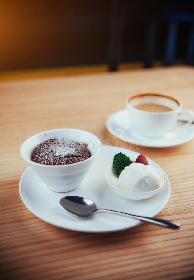 Cake ice cream with chocolate and cappuccino. In the background stock photography