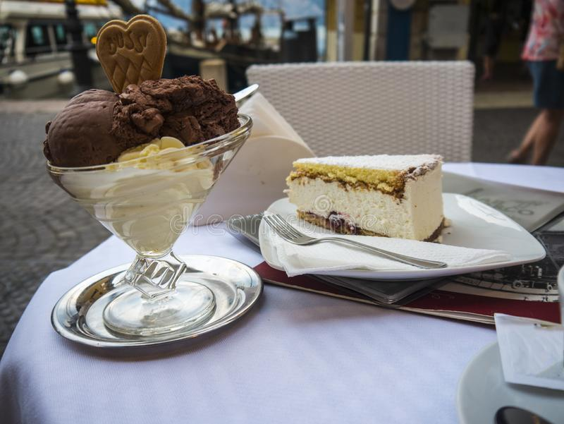 Cake and ice cream in the lovely town of Malcesine on Lake Garda where is famous castle guards the entrance to its harbour. Lake Garda is a popular European royalty free stock photo
