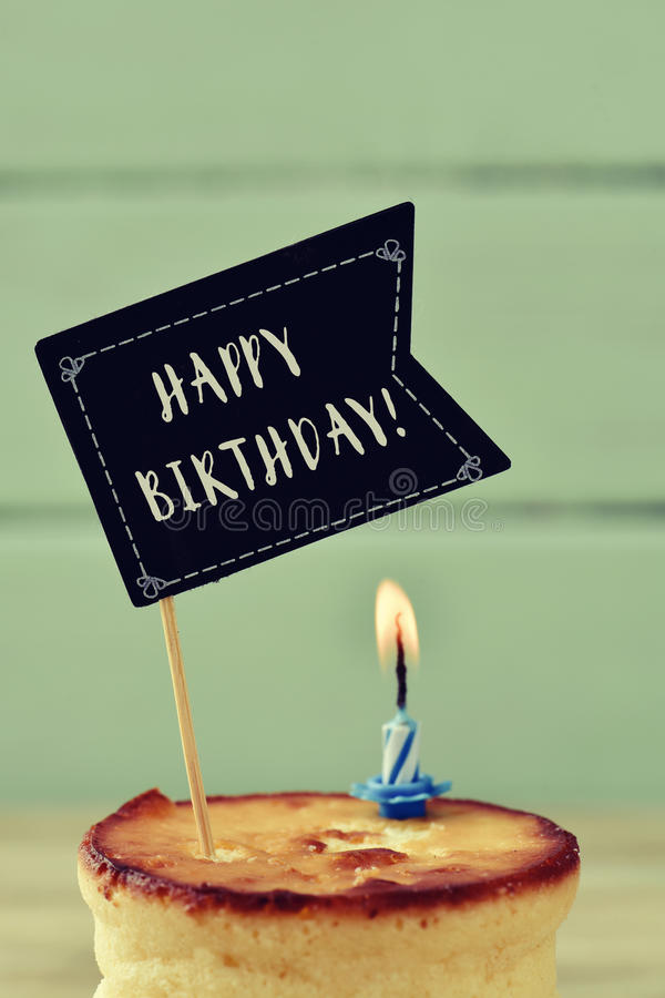 Cake, lit candle and text happy birthday royalty free stock photo