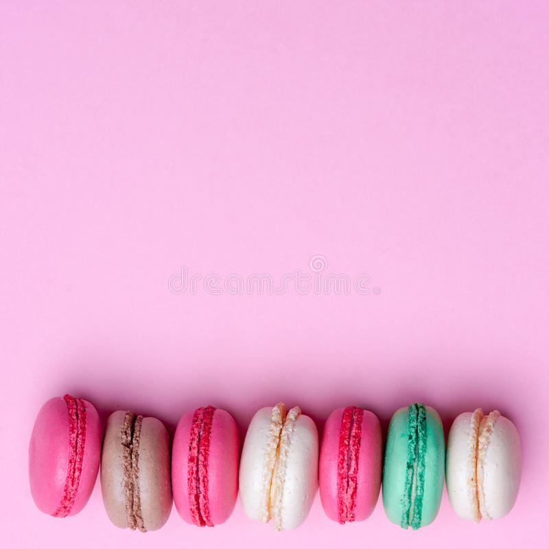 Cake macaron or macaroon on turquoise background from above, colorful almond cookies, pastel colors, vintage card, top stock photos