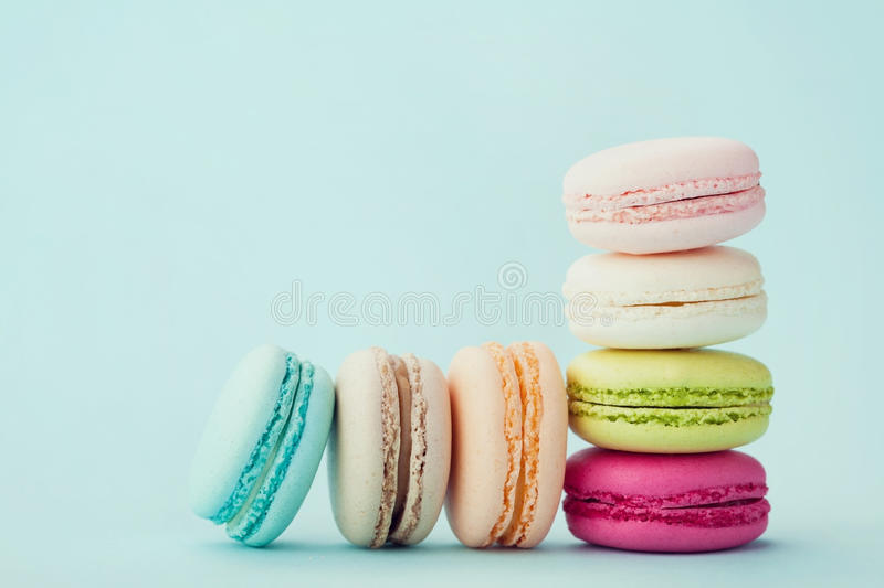 Cake macaron or macaroon on turquoise background, flavor almond cookies, pastel colors royalty free stock images