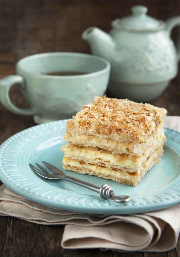 Cake Napoleon. And cup of tea stock images