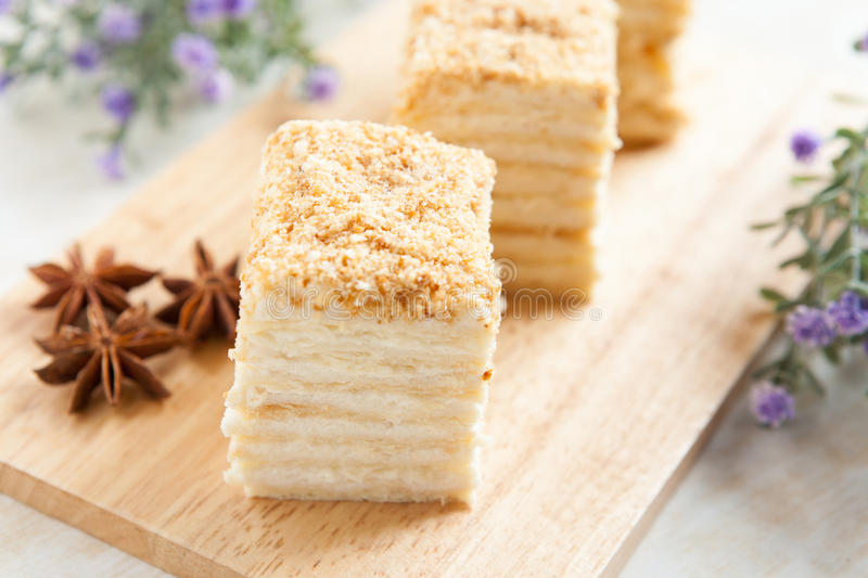 Cake Napoleon of puff pastry with sour cream. Tasty dessert royalty free stock photo