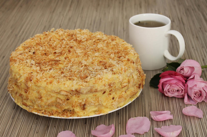 Cake Napoleon. Rose and coffee stock images