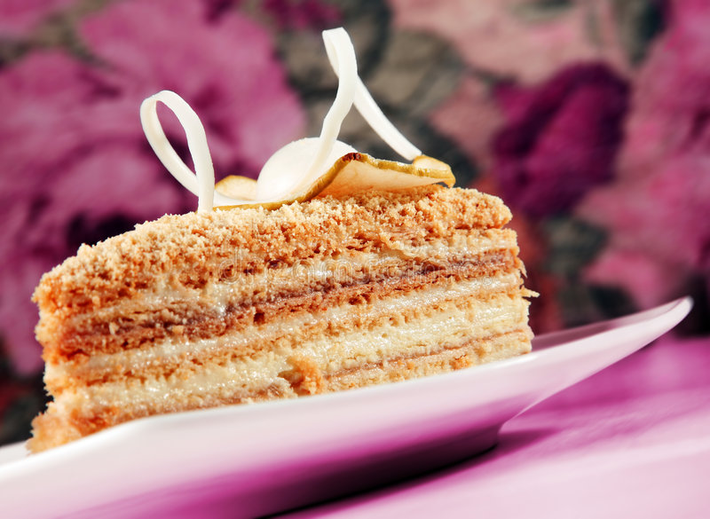 Cake Napoleon slice. Closeup in pink background royalty free stock photo