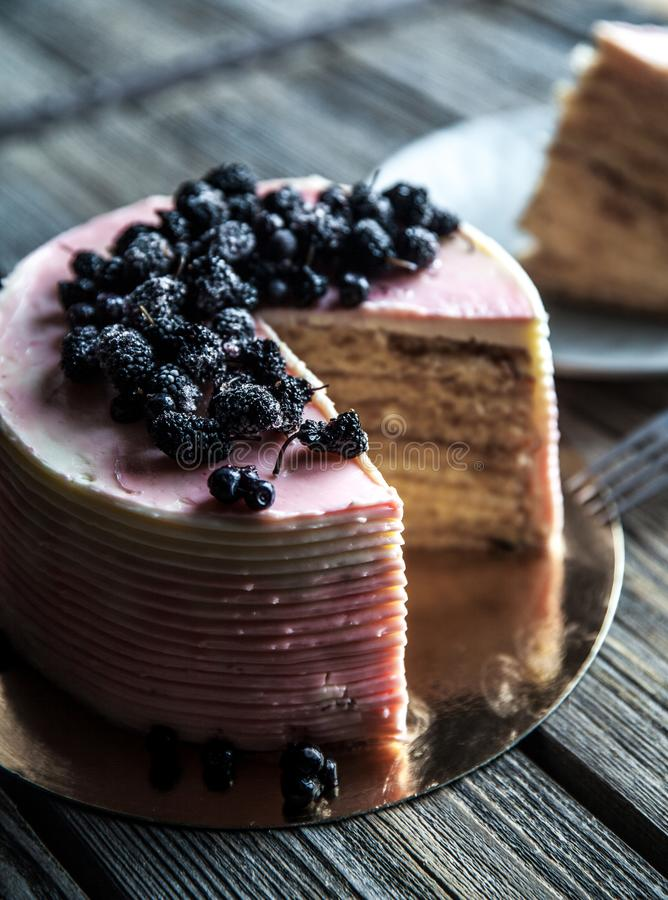 Cake with a pink tint with blueberries. A stock photo
