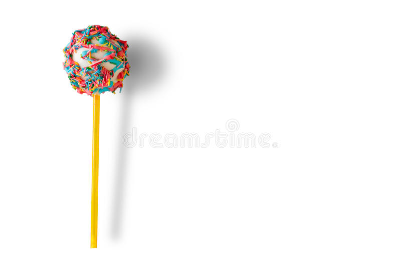 Cake pop with sprinkles. Candy on white background. Eat well and have fun. Boost your mood royalty free stock photography