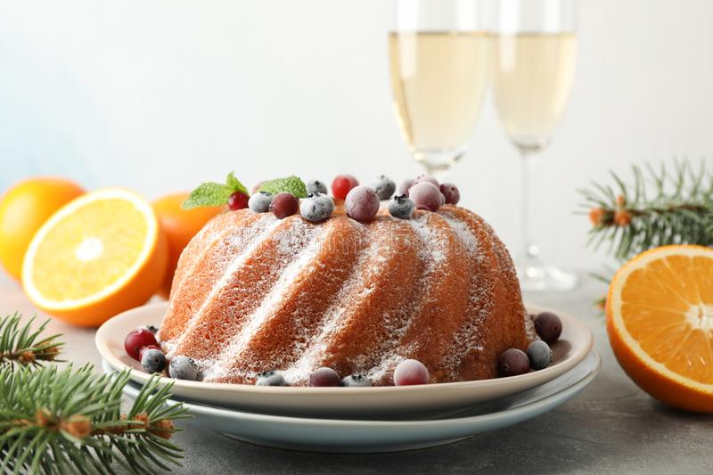 Cake with powder sugar and berries on grey table. Happy new year. Concept royalty free stock photography