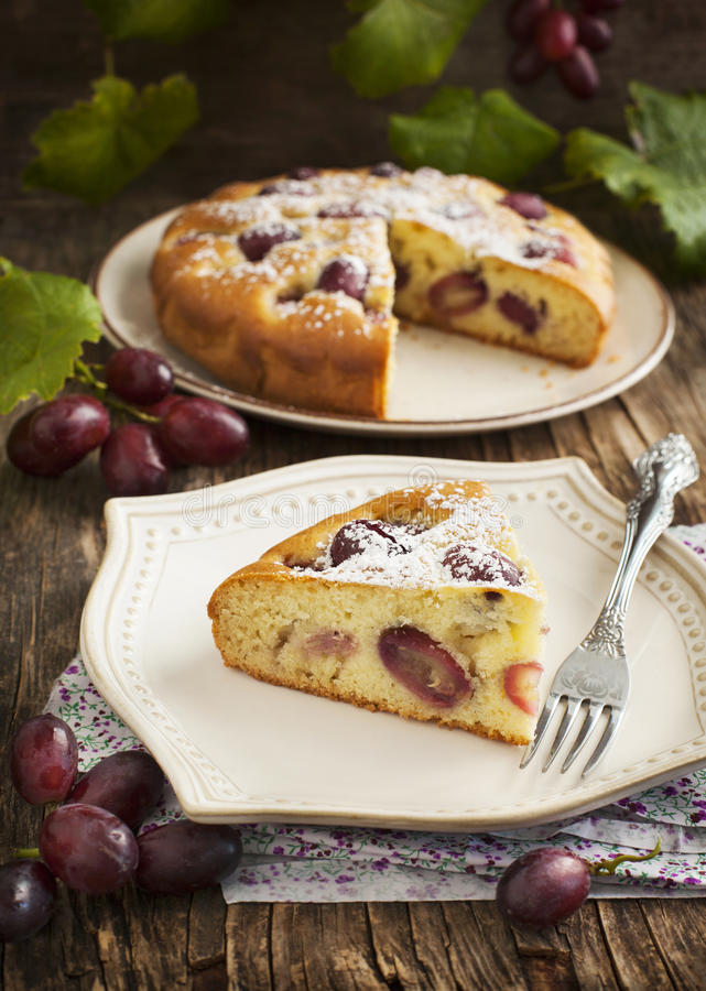 Cake with red grapes stock images