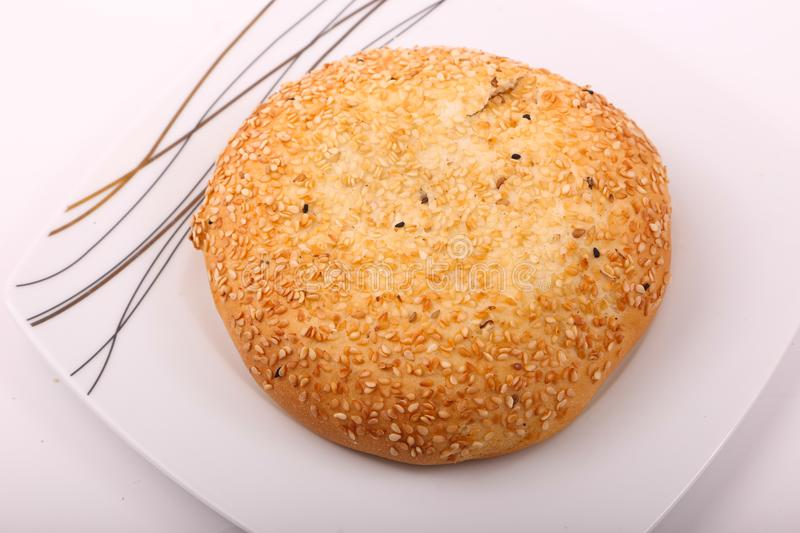 Cake with sesame. On white plate on white background stock images