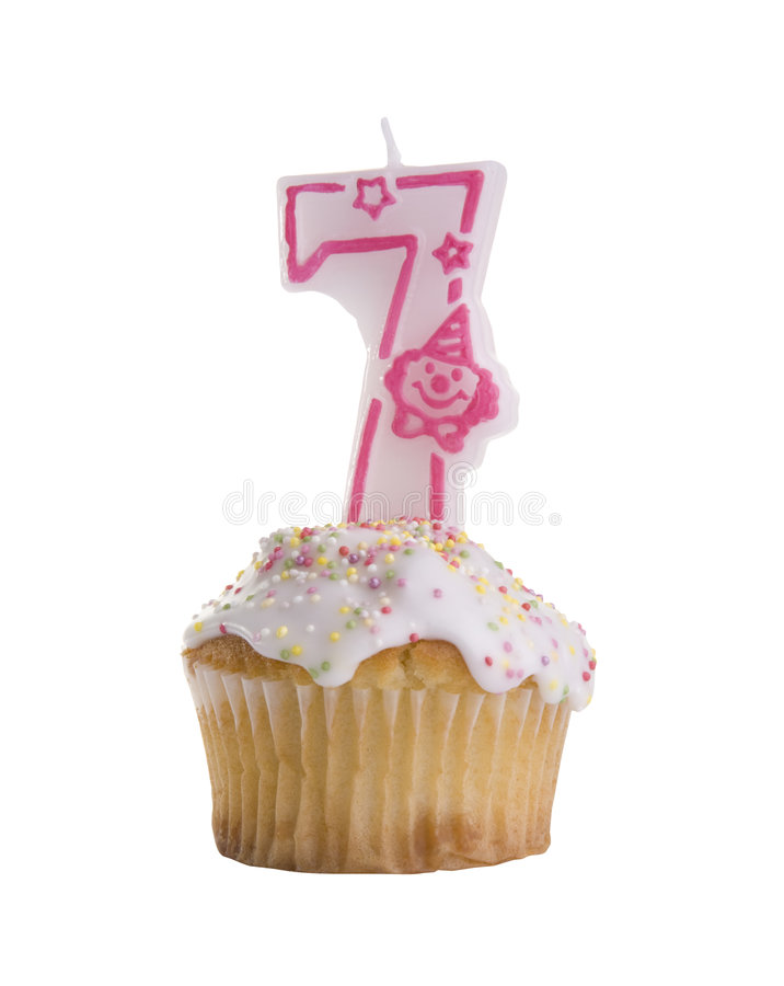 Cake Seven. Birthday cupcake with numbered candle on white background. I have many other numbers, please see my other images. TWO CLIPPING PATHS INCLUDED for stock images