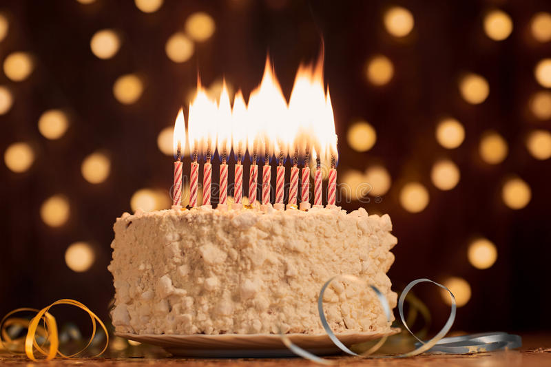 Birthday Cake Shot Images ~ Cake shot on a bokeh background with candles stock photo image
