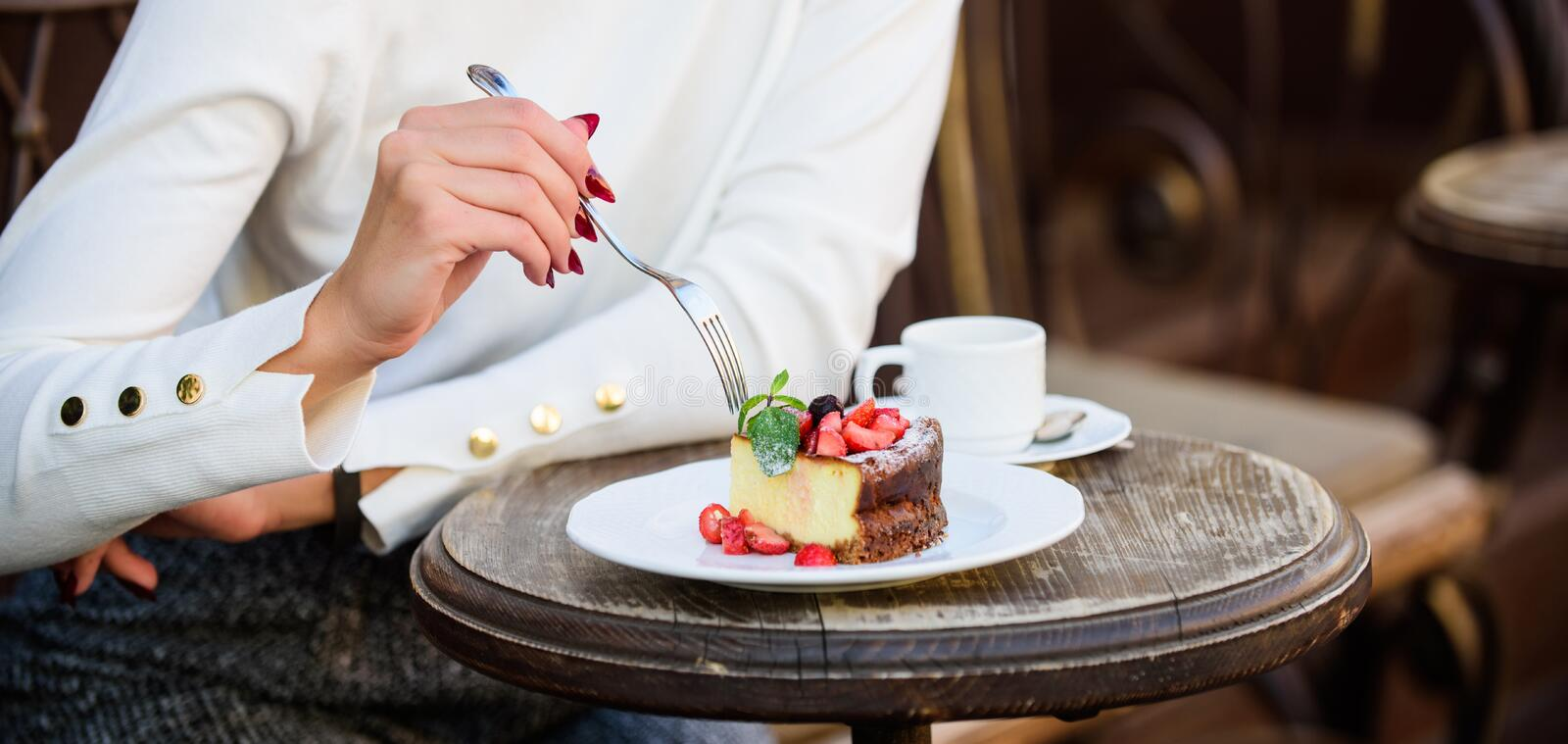 Cake slice on white plate. Cake with cream delicious dessert. Appetite concept. Dessert cake cup of coffee and female stock image
