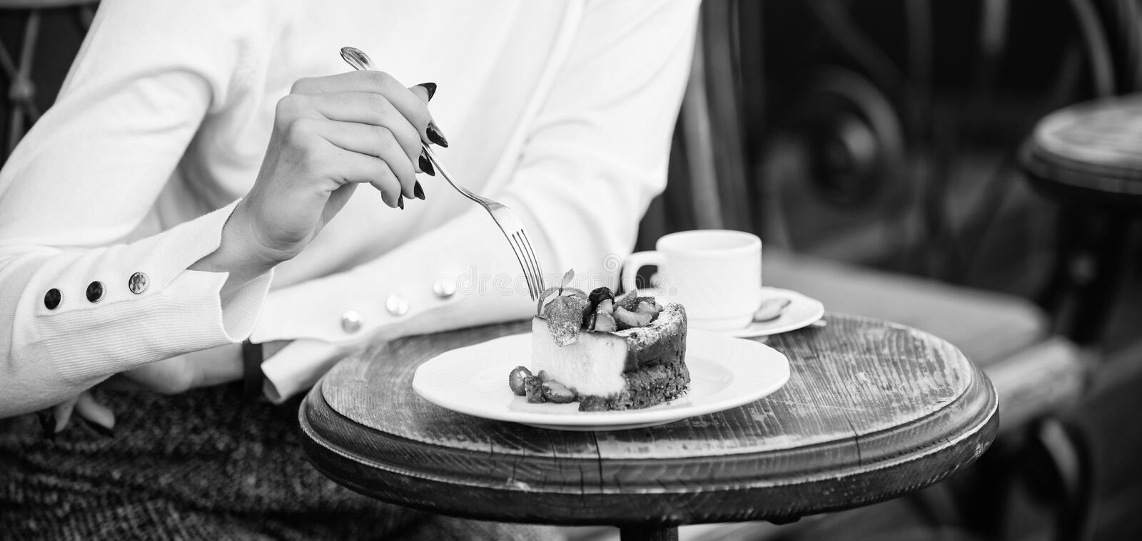 Cake slice on white plate. Cake with cream delicious dessert. Appetite concept. Dessert cake cup of coffee and female royalty free stock image