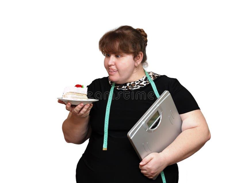 cake som bantar överviktiga kvinnor royaltyfri bild