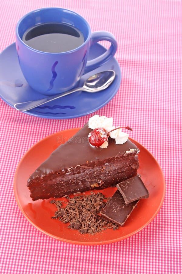 Cake and tea. Slice of chocolate cake and cup of tea stock photo