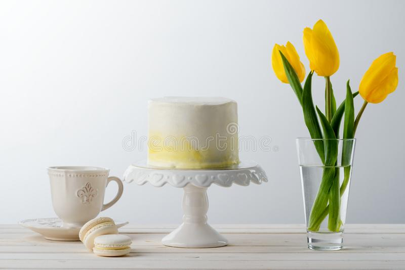 Cake, tea cup and tulips stock images