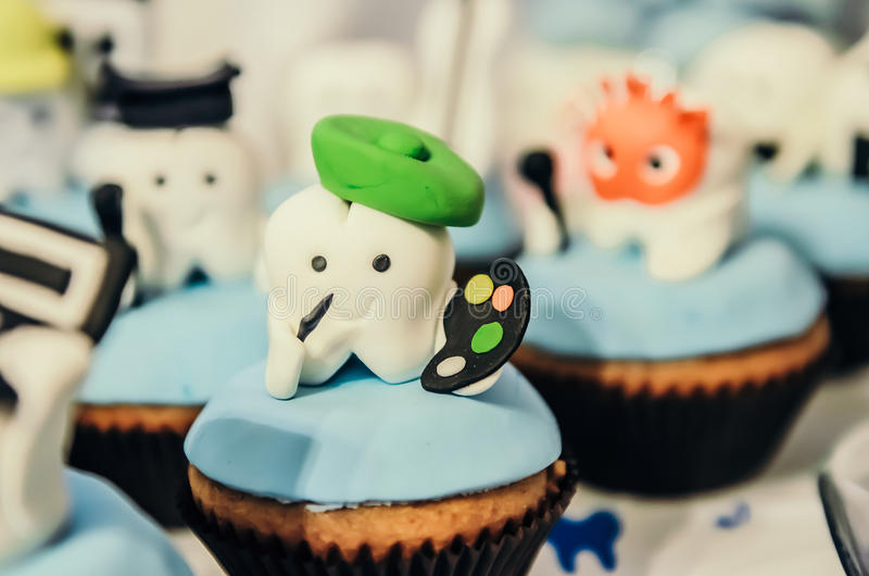 Cake with tooth hero on top royalty free stock images